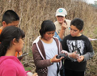 Amesti elementary school children learn to use scientific intruments during field work in Watsonville Sloughs