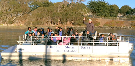 Large group of students on flat-bottomed boat on Elkhorn Slough
